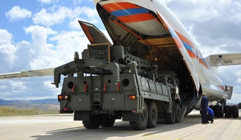 Military vehicles and equipment, parts of the S-400 air defense systems, are unloaded from a Russian transport aircraft, at Murted military airport in Ankara, Turkey, Friday, July 12, 2019.