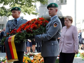 Merkel takes part in a wreath-laying ceremony to commemorate the 75th anniversary of the assassination attempt, July 20, 2019.