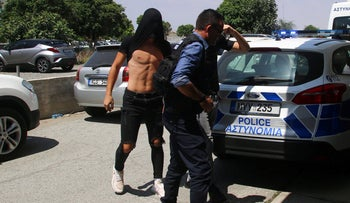 Israeli tourists arrested over alleged rape arrive to appear before a magistrate for a remand hearing in the Famagusta courthouse in Paralimni, Cyprus, July 18, 2019.