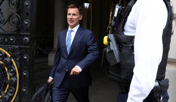 Britain's Foreign Secretary Jeremy Hunt leaves 10 Downing Street for talks about British tanker captured by Iran, July 20, 2019.