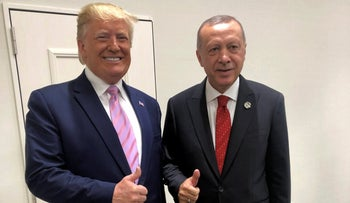 File photo: Turkey's President Recep Tayyip Erdogan, right, and U.S. President Donald Trump gesture during the G-20 summit in Osaka, Japan, Friday, June 28, 2019.