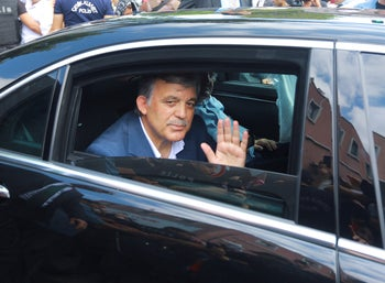 Former Turkish President Abdullah Gul leaves a memorial service for the victims of the thwarted coup in Istanbul, Turkey, July 17, 2016.