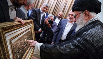Khamenei points to a relief depicting Jerusalem and the Dome of the Rock during his meeting with a Hamas delegation in Tehran, July 22, 2019.