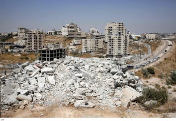 Israeli security forces tearing down one of the Palestinian buildings in the West Bank village of Dar Salah, July 22, 2019.