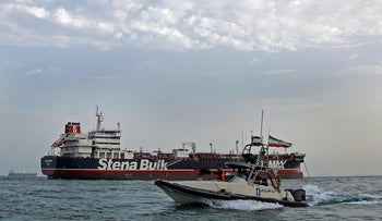 Iran's Revolutionary Guards patrol a British-flagged oil tanker which was seized, in the Iranian port of Bandar Abbas, July 21, 2019.