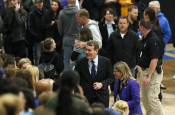 Sen. Michael Bennet greeting attendees during a community vigil to honor the victims and survivors of a fatal shooting at the STEM School Highlands Ranch in Colorado, May 8, 2019.