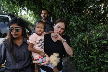 Esta and her daughter being led out of her home by immigration authorities, July 23, 2019.
