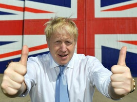 Boris Johnson giving the thumbs up at a shipyard during a visit to the Isle of Wight, England, June 27, 2019.