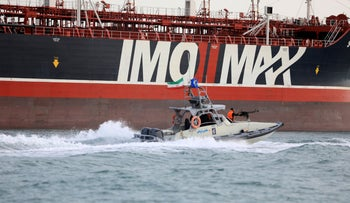 A speedboat of the Iran's Revolutionary Guard moves around a British-flagged oil tanker Stena Impero which was seized in the Strait of Hormuz on Friday by the Guard, in the Iranian port of Bandar Abbas, July 21, 2019.