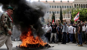 File photo: Lebanese retired soldiers burn tires as they protest in front of the government building during a cabinet meeting to discuss an austerity budget, in Beirut, Lebanon, Friday, May 10, 2019.