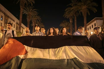 Moroccans carry a Palestinian flag during a demonstration against a visit by Trump senior advisor Jared Kushner and his Mideast peace plan, in Rabat, Morocco. June 1, 2019