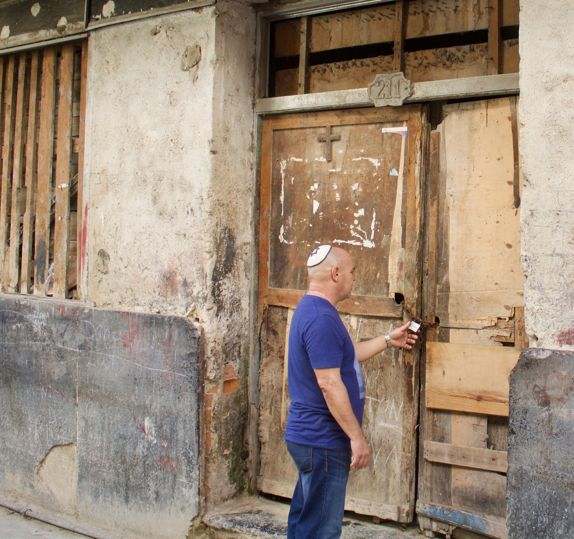 Fidel Babani Leon at the entrance to a former kosher restaurant in Havana.