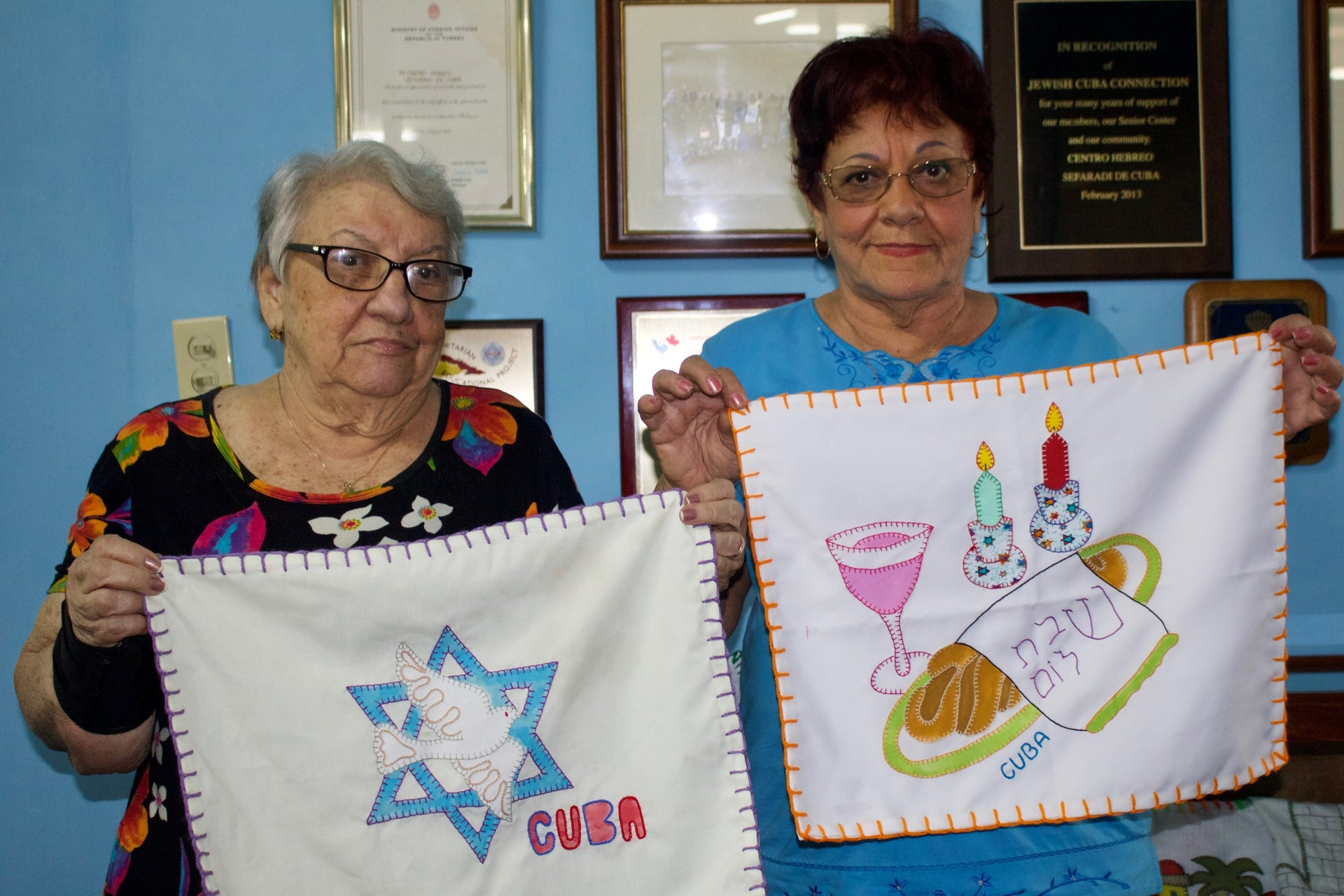 Women showing craft they made at the Hebrew Sephardic Center in Havana.