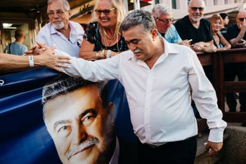 Amir Peretz celebrates after winning the Labor primary, July 9, 2019.