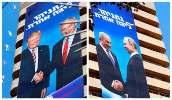 Likud election banners showing Netanyahu shaking hands with Trump and with Putin, Tel Aviv, July 28, 2019.