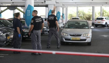 Police officers on the scene of a mall shooting, Ramle, Israel, July 28, 2019.