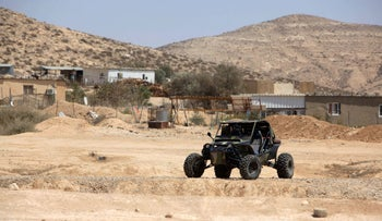 An all-terrain vehicle seen near homes in a Bedouin community in the Negev.