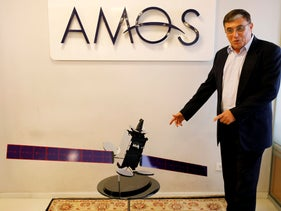 Spacecom CEO David Pollack next to a model of the Amos 17 satellite, July 28, 2019.