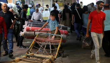 A young worker takes a break on his cart at the old main bazaar in Tehran, Iran, Sunday, June 23, 2019