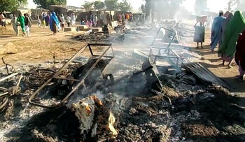 Smoldering ashes and charred items are seen on the ground in Budu near Maiduguri on July 28, 2019.