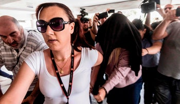 British 19-year-old woman who accused twelve Israelis of gang rape arriving at the Famagusta District Court in Paralimni in eastern Cyprus, to face charges of making a false allegation, July 29, 2019.