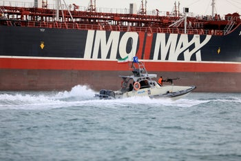 An Iran's Revolutionary Guard speedboat moves around the UK-flagged oil tanker Stena Impero seized in the Strait of Hormuz by the Guard, in the Iranian port of Bandar Abbas. July 21, 2019