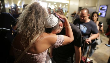 One of the Israeli boys involved in the Cyprus rape case arrives at Ben Gurion airport, in Tel Aviv, on Sunday, July 28, 2019.