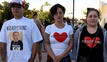 Becky Valdez (C) with her children Jose Estrada (L) and Alexis Estrada (R),outside of Gilroy City Hall, attend a vigil for the victims of a mass shooting at the Gilroy Garlic Festival a day earlier, in Gilroy, California, U.S. July 29, 2019