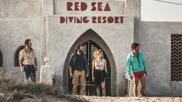 "Alessandro Nivola, Chris Evans, Haley Bennett and Michiel Huisman in Netflix's ""The Red Sea Diving Resort."""