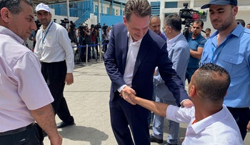 UNRWA Commissioner-General Pierre Krahenbuhl shakes hands with a Palestinian man  in Gaza City on May 23, 2019.