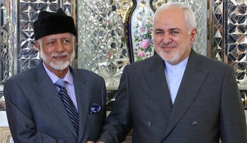 Iran's Foreign Minister Mohammad Javad Zarif shakes hands with Oman's Minister of State for Foreign Affairs Yousuf bin Alawi bin Abdullah in Tehran on July 27, 2019