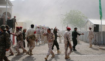 Soldiers rush to help the injured following a missile attack on a military parade during a graduation ceremony for newly recruited troopers in Aden, Yemen August 1, 2019.