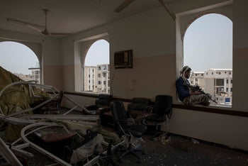 A solider guards the site of a deadly attack inside the Sheikh Othman police station in Aden, Yemen, Thursday, Aug. 1, 2019.