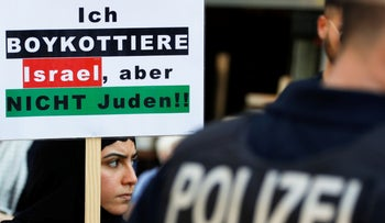"""An al-Quds Day demonstration in Berlin, June 2019. The poster reads, """"I boycott Israel, but not the Jews."""""""