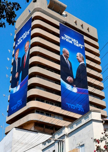"Two Likud Party banners in Tel Aviv show Netanyahu shaking hands with Trump and Putin. The caption says ""Netanyahu, in another league."" July 28, 2019."