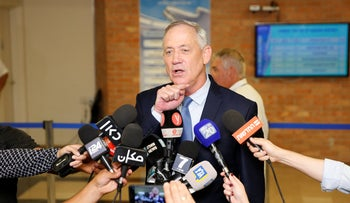 Benny Gantz talks to reporters before party registration ends in the Knesset, August 1, 2019.