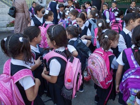 Israeli children seen with book bags at the first day of school, 2015.