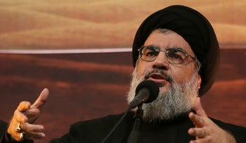 Hezbollah leader Hassan Nasrallah addresses supporters ahead of the Shiite Ashura commemorations, in Beirut's southern suburbs. Nov. 3, 2014.