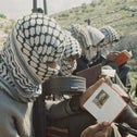"""Armed Palestinian fighters from the Fatah faction of the Palestine Liberation Organization reading copies of """"Quotations from Chairman Mao Zedong"""" (or """"Little Red Book"""") in Jordan, 1970."""