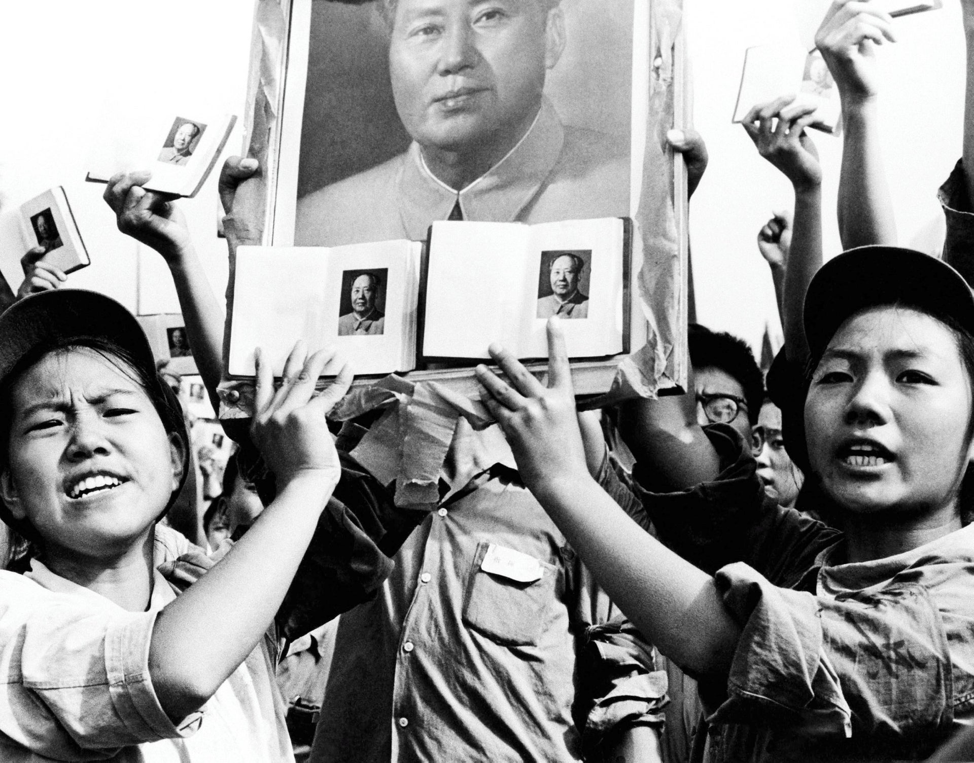 Members of the Red Guard holding up books and images of Chairman Mao Zedong, Beijing, September 14, 1966.