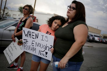 People taking part in a rally against hate a day after a mass shooting at a Walmart store, El Paso, Texas, August 4, 2019.