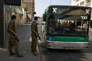 Armed Israeli soldiers on the streets of Jerusalem in 2015.