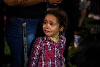 Serenity Lara cries during a vigil a day after a mass shooting in El Paso, Texas, August 4, 2019.