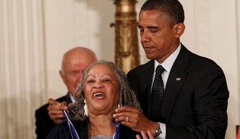 U.S. President Barack Obama awards novelist Toni Morrison a 2012 Presidential Medal of Freedom during a ceremony in the East Room of the White House in Washington, May 29, 2012