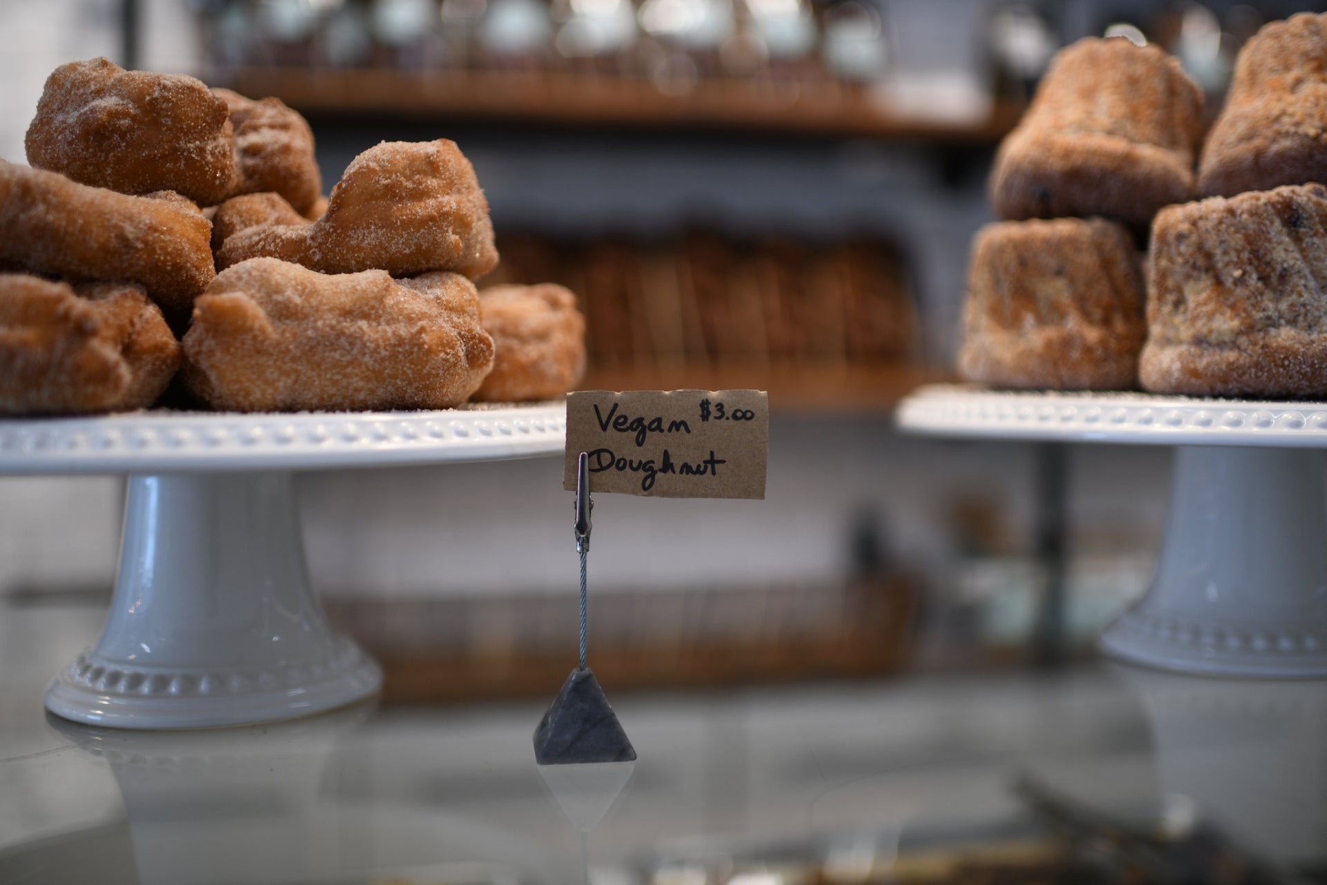 Sfenj doughnuts and kugelhopf on display at the Michaeli bakery, June 7, 2019