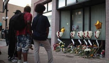 Mourners visit a memorial to those killed in Sunday morning's mass in the Oregon District of Dayton, Ohio, August 06, 2019.