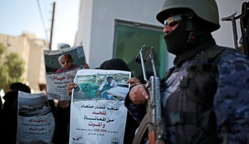 """A Yemeni woman holds a banner with Arabic that reads: """"Open Sanaa airport to limit the suffering and deaths!"""" during a protest in front of the U.N. offices in Sanaa, Yemen, December 10, 2018."""