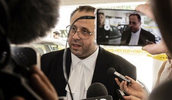 Andreas Pittadjis, the lawyer of a British teenager who was arrested on suspicion of falsely accusing 12 Israeli tourists of gang rape, speaks to the press outside the Famagusta district court on August 7, 2019.