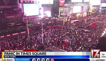 A backfiring motorcycle caused hundreds in Times Square to scatter after they thought a shot had been fired.
