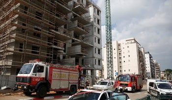 Emergency services at the scene of a construction-site accident in Petah Tikva, Israel, January 26, 2019.
